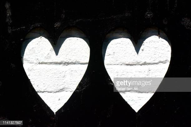 two hearts symbols - rafael ben ari stock pictures, royalty-free photos & images