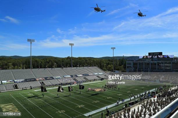 Two helicopters perform a fly over as the Army Black Knights take the field before their game against the Middle Tennessee Blue Raiders at Michie...