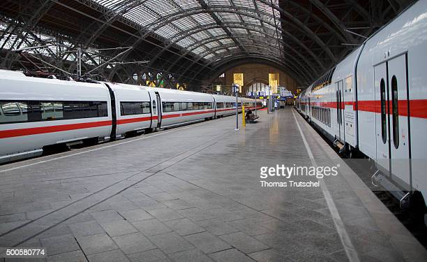 Two highspeed trains of Deutsche Bahn AG are in Leipzig Hauptbahnhof along a deserted platform on December 09 2015 in Leipzig Germany