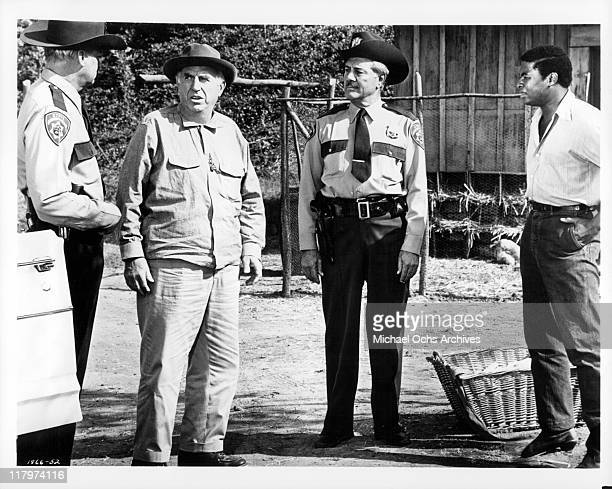 Two Highway patrolmen help Ed Begley back home in a scene from the film 'A Time to Sing' 1968