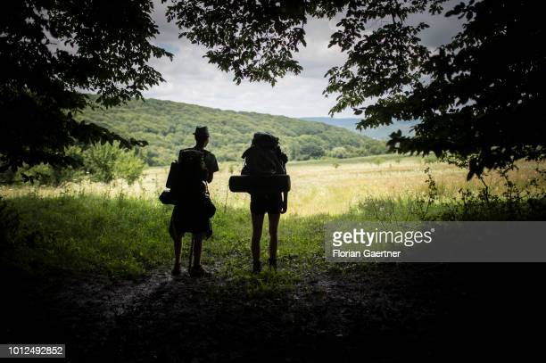 Two hikers are pictured in front of a glade on July 25 2018 in Sighisoara Romania