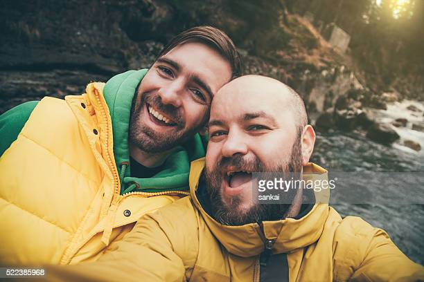 Two hikers taking selfie in mountains