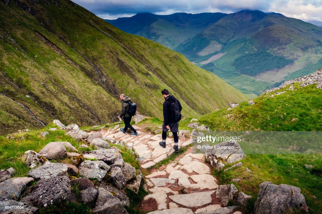 Two hikers walking down a path : Stock Photo