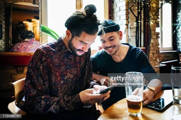 two hipster drinking together - generation z stock-fotos und bilder