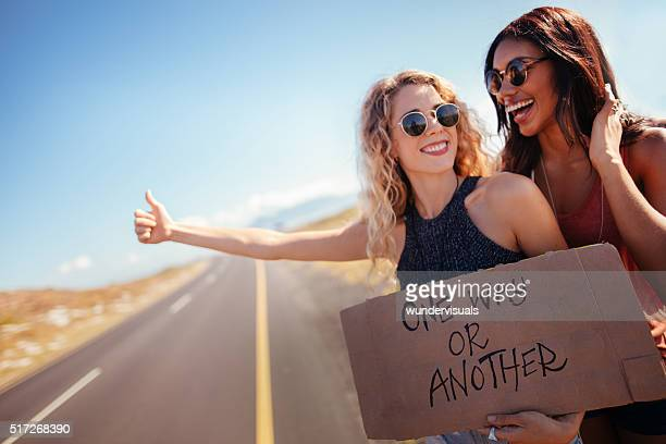 Two Hipster Girls Hitchhiking Together