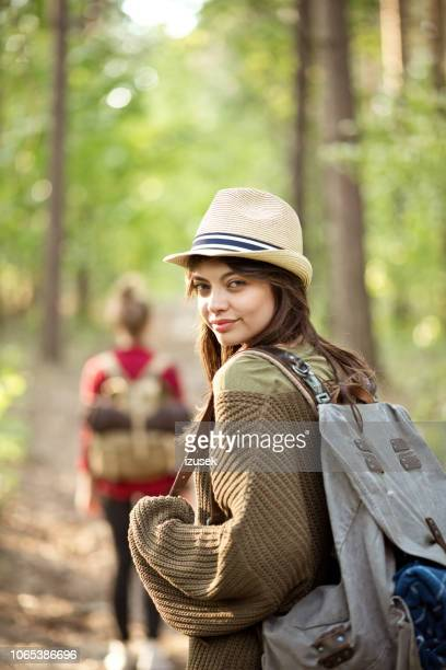 two hipster girls walking in the forest - izusek stock pictures, royalty-free photos & images