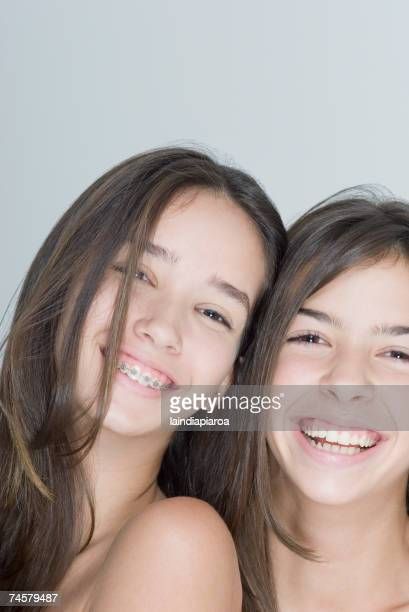two hispanic teenage girls smiling - beautiful girl smile braces vertical stock photos and pictures