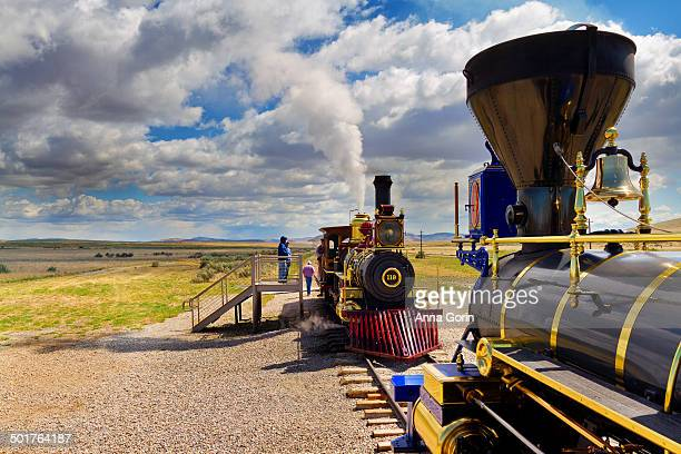 Two historic replica trains facing each other on railroad tracks at Golden Spike National Historic Site in Utah, joining point of Union and Central...