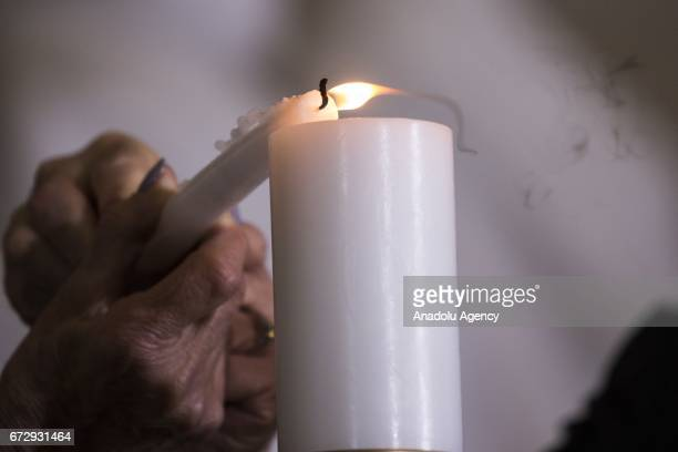 Two holocaust survivors light a memorial candle during the US Holocaust Memorial Museums National Days of Remembrance ceremony in the Rotunda of the...