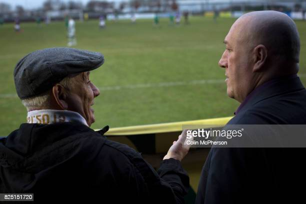 Two home supporters chatting during the firsthalf at the Delta Taxis Stadium Bootle Merseyside as City of Liverpool hosted Holker Old Boys in a North...