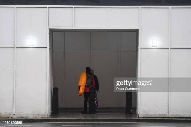 Two homeless people are seen talking on December 13, 2020 in London, England. The number of new rough sleepers has risen in London this year amid the...