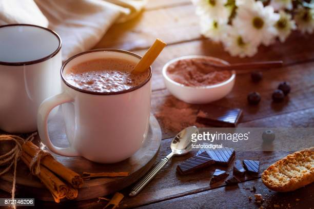 two homemade hot chocolate mugs on rustic wooden table - country christmas stock pictures, royalty-free photos & images