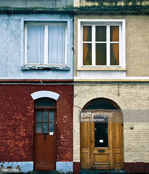 Two homes photographed from the street