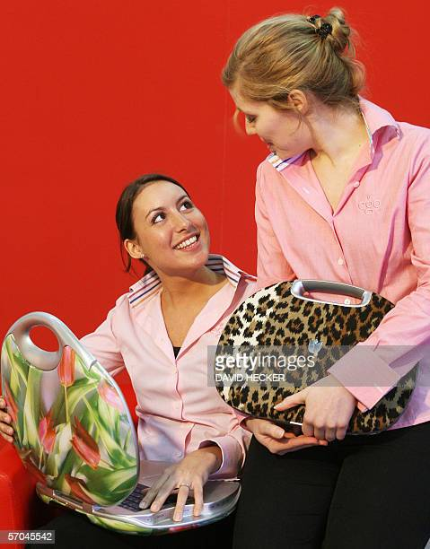 Two hostesses of Duutch company ego present so-called Lifestyle-Computers with exchangable handbag shaped cover, during the 2006 CeBIT information...
