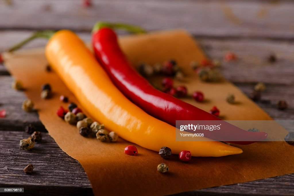Two hot chili peppers with pepper seeds : Stock Photo