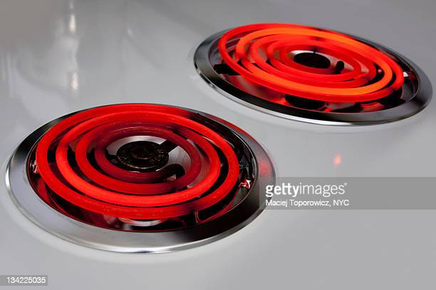 Two hot electric burners in kitchen stove