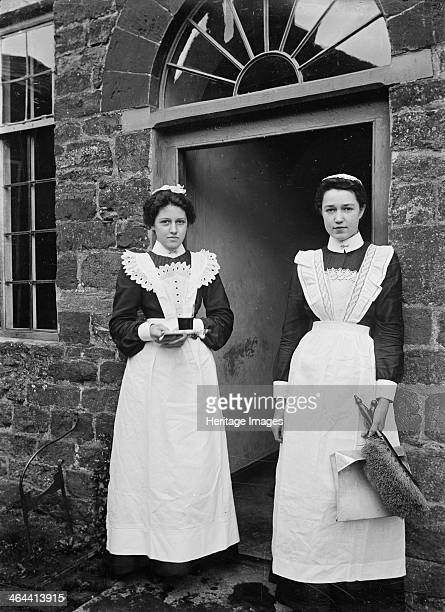 Two housemaids standing in the doorway of a house Byfield Northamptonshire c1896c1920 Two maids standing in the doorway of an unidentified house One...