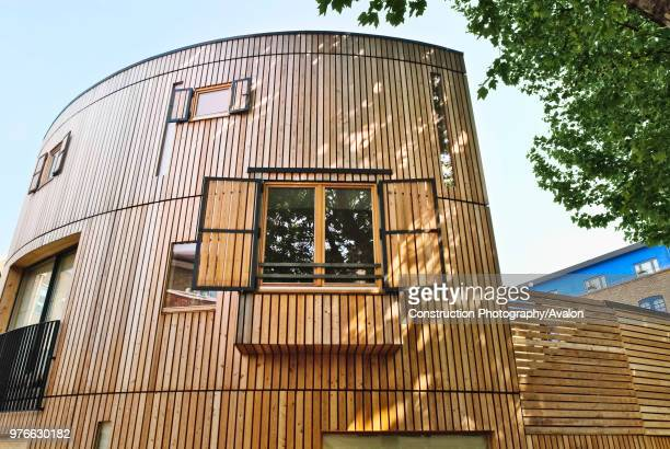Two houses built with solid wood walls, layered to some six to eight inches thick, forming a breathable skeleton, and allowing the house to create...