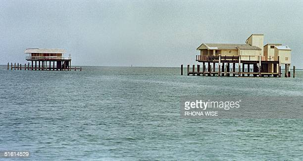 Two houses in Stiltsville sit quietly in the Biscayne Park waters 21 June as the future of the remaining seven houses just off Key Biscayne, Florida,...