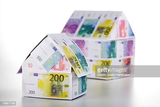 two houses of euro notes, close-up - banconote euro foto e immagini stock