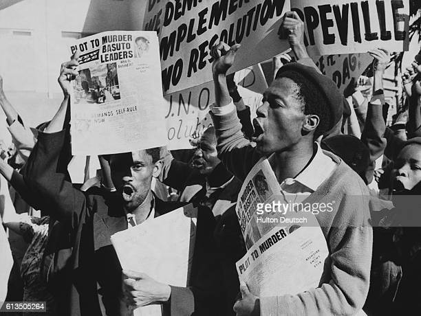 Two hundred and fifty South Africans and other nonEuropeans demonstrate outside the hotel of Mr Dag Hammarskjold the SecretaryGeneral of the United...