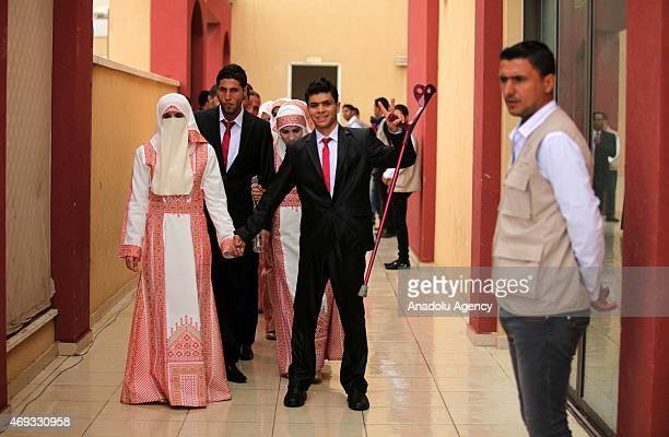 Two hundred couples get married during a mass wedding ceremony held by the Fata Palestine Rehabilitation Center and financially supported by the...