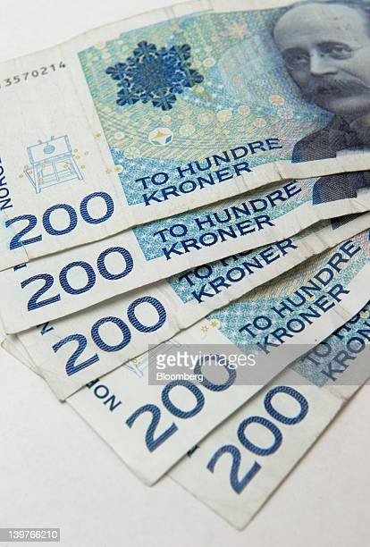 Two hundred krone Norwegian currency notes are seen in this arranged photograph in Oslo Norway on Thursday Feb 23 2012 Declining joblessness suggests...