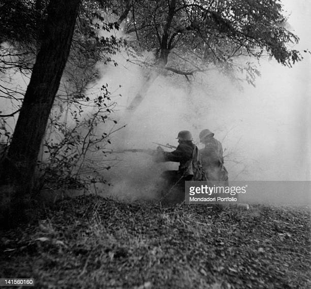 Two Hungarian army soldiers kneel to fire during the battle of Azov Russia October 1941