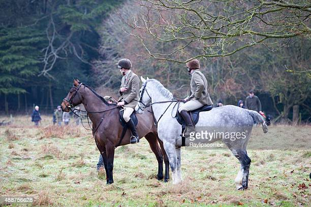 two huntsmen taking a glass of mulled wine - fox hunting stock pictures, royalty-free photos & images