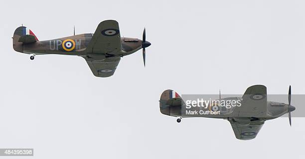 Two Hurricane fighters take part in a Battle of Britain flypast on August 18, 2015 in Biggin Hill, England. A total of 18 Spitfires and six...