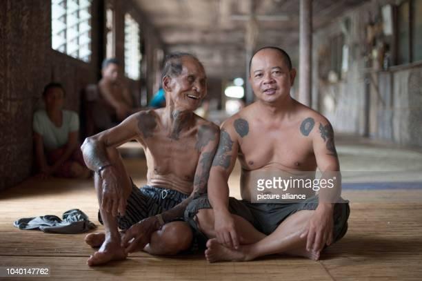 Two Iban men are sitting inside a traditional Iban longhouse near Lubok Antu Malaysia on Photo Sebastian Kahnert NOWIRESERVICE   usage worldwide