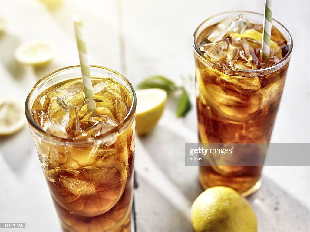two ice cold glasses of iced tea with lemons : Stock Photo