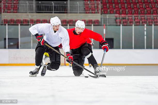 two ice hockey players dueling - ice hockey glove stock pictures, royalty-free photos & images