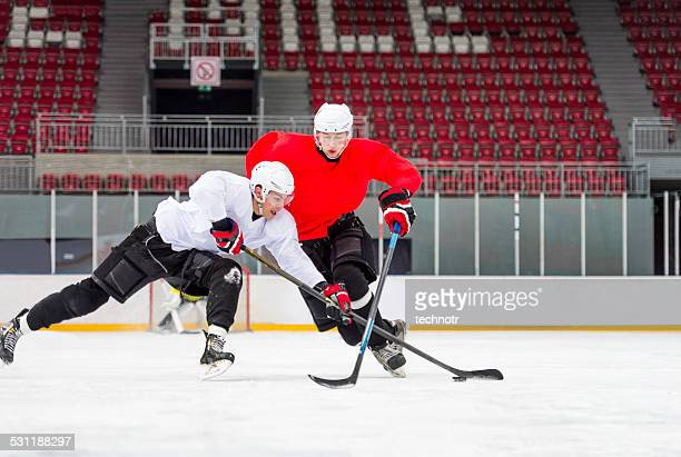 two ice hockey players dueling - sports league stock pictures, royalty-free photos & images