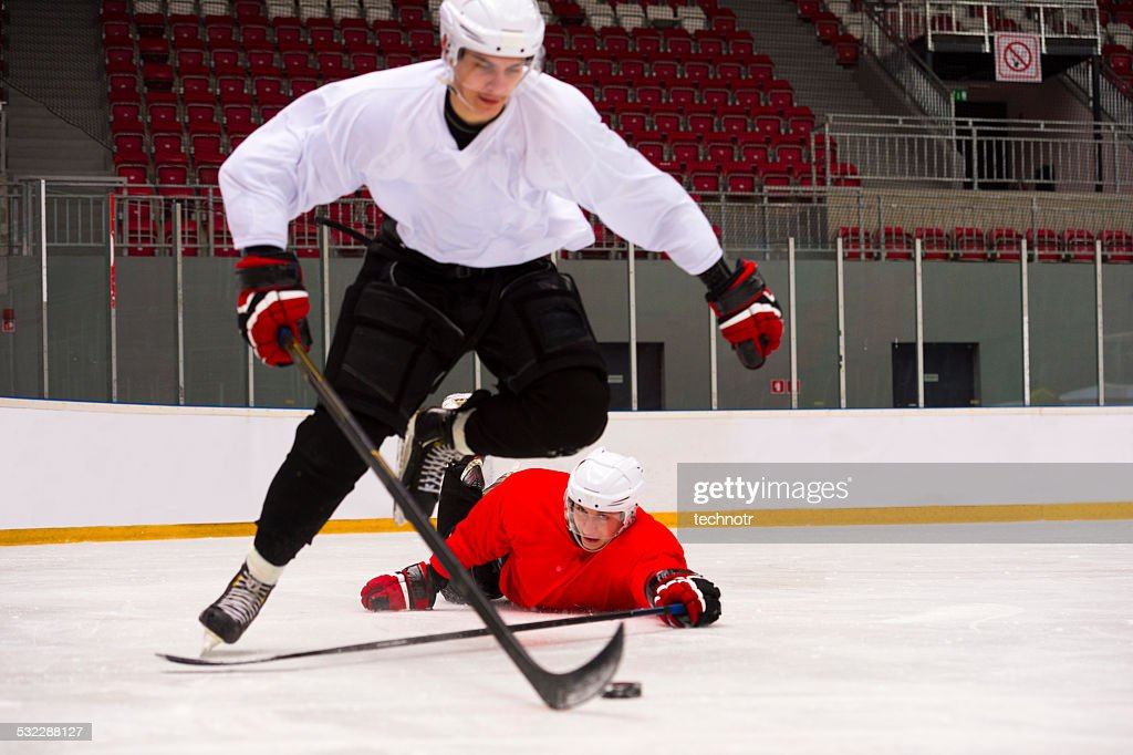 Two Ice Hockey Players in a Hard Duell : Stock Photo
