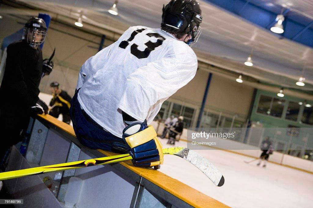 Two ice hockey players watching ice hockey : Stock Photo