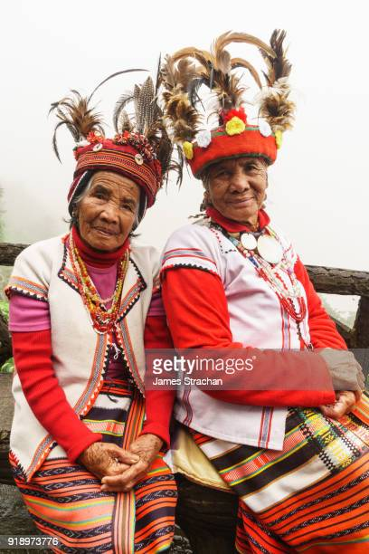 Two Ifugao (ancient culture of wet-rice agriculturalists) women in traditional dress and hats, Banaue, Luzon Island, Philippines (Model Releases, both)
