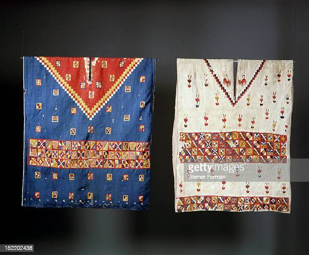 Two Inca ponchos with geometric designs, worn by a people of high status, One is decorated with plants and felines. The cantuta flowers were popular...