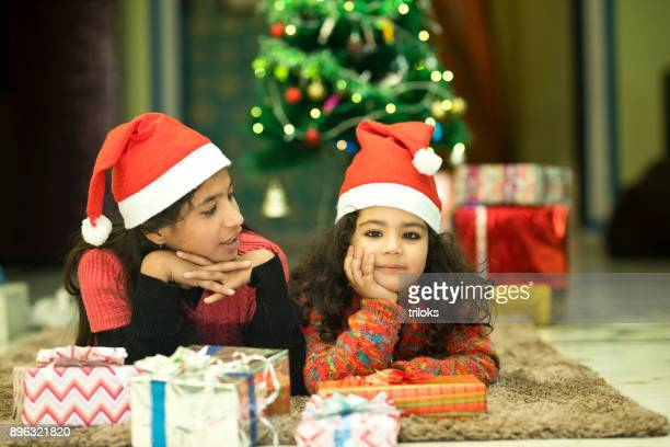 Two Indian girls in Santa hat