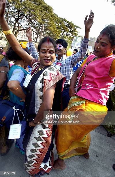 Two Indian Hijras or transexuals dance during a protest march of sex workers at the 2004 World Social Forum in Bombay 18 January 2004...