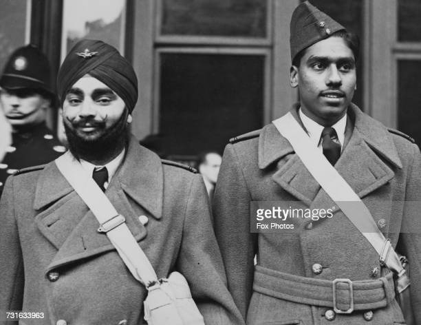 Two Indian pilots who have just arrived in Britain to serve with the RAF at a London railway station 8th October 1940 The men are part of the first...
