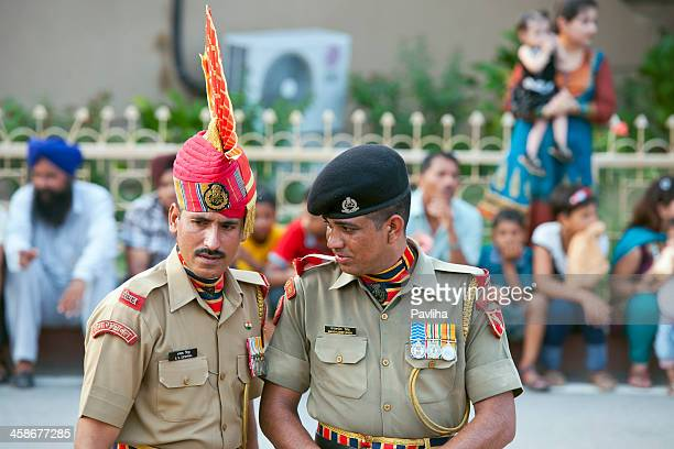 two indian soldiers in wagah pakistani border - indian military stock photos and pictures