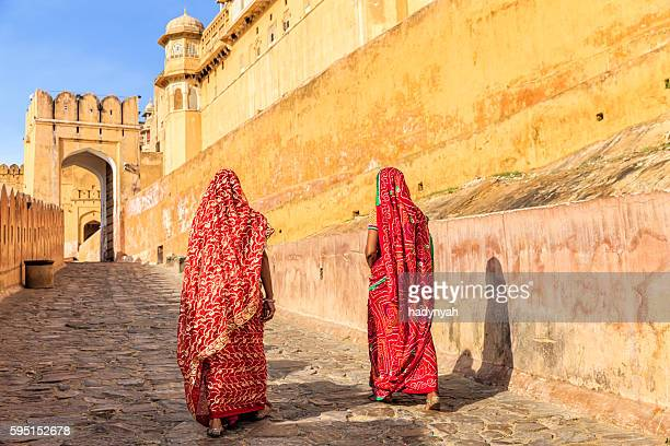 two indian women on the way to amber fort, india - amber fort stock pictures, royalty-free photos & images
