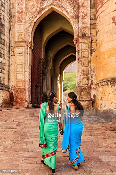 two indian women on the way to mehrangarh fort, india - jodhpur stock pictures, royalty-free photos & images