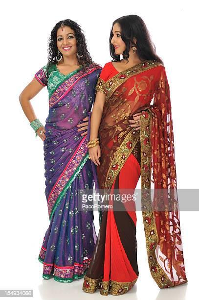 two indian women wearing saris - sari stock pictures, royalty-free photos & images