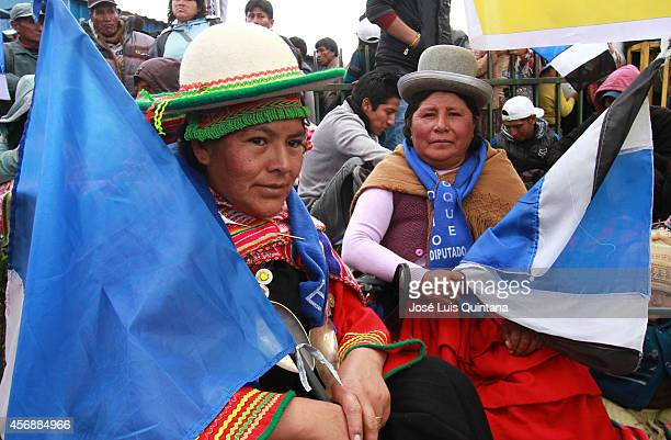 Two indigenous Aymara women supporters of Bolivia's president and presidential candidate of the Socialist Movement Evo Morales attend the closing...