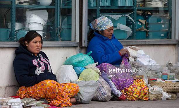 Two indigenous Raramuris sell they products in the street of Ciudad Juarez, Chihuahua state, Mexico on January 24, 2012. Some indigenous families...