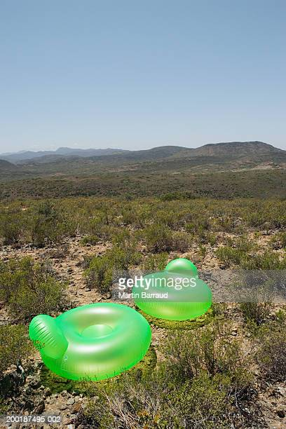 Two inflatable chairs in rugged landscape, elevated view
