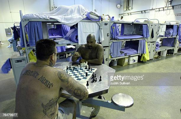 Two inmates at the Mule Creek State Prison play chess in a gymnasium that was modified to house prisoners August 28 2007 in Ione California A panel...