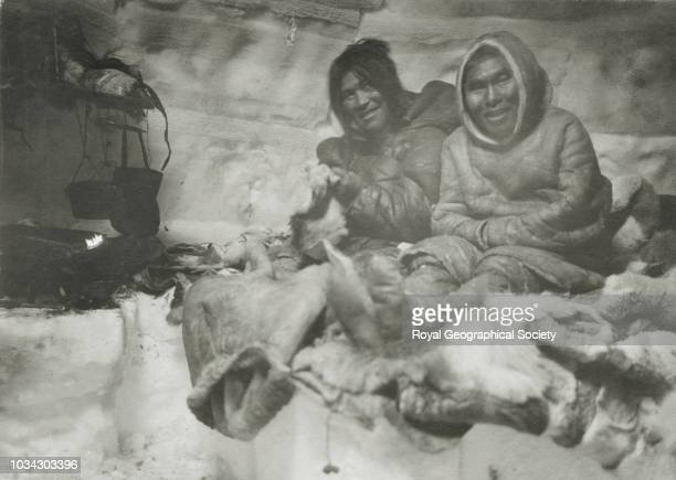 Two innuit with skin sleeping bags Original caption reads 'Nechilli in their snow hut' Arctic circa 1903